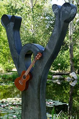 Statue of Peter wearing ukulele at the Yampa River Botanic Park.
