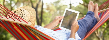 Reading on a tablet while lying in a hammock